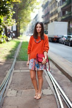 Oversized bright top and patterned skirt or shorts