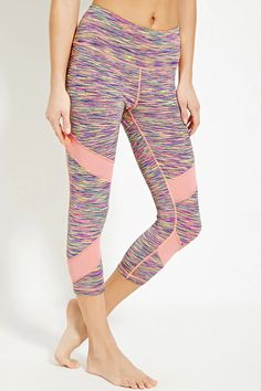 In a stretch knit, these TLF™ athletic capri leggings feature a vibrant space dye print, mesh-paneled legs, a hidden key pocket, and moisture management. .