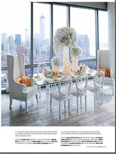 Gorgeous white table with peach feather accents. Shown here in Trump Tower New York, the sleek white furniture matches the modern decor but adds a touch of feminine and glamour. Click to see the feature or pin for later!