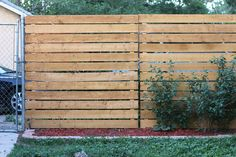 This blogger fastened cedar panels to her chain link fence.