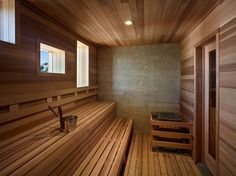 The home's lower level includes a powder room, mud room and sauna. The large sauna is designed to fit several families, the perfect respite after a long day of hiking or skiing on the slopes. Modern Wooden House, Modern Rustic, Mid-century Modern, Sauna Design, Cabin Design, House Design, Contemporary Saunas, Outdoor Sauna, Sauna Room