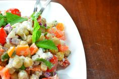 Chickpea salad with feta cheese and sun-dried tomatoes. Healthy vegetarian and gluten-free meal.