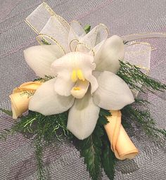 pin on corsage with white orchid, and soft peach rose petals with gold ribbons and greens designed by Lynn Dunford at Van Gogh Flowers. Love Flowers, Wedding Flowers, Van Gogh Flowers, Homecoming Flowers, Peach Rose, Corsage Wedding, Gold Ribbons, Local Florist, White Orchids