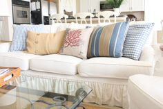 Blue and khaki pillows bring the seashore to your living room
