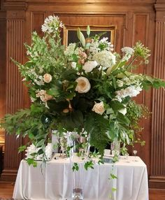 Gardeny mix of magnolia, Queen Anne's lace, agapanthus, roses.   In bloom, ltd.