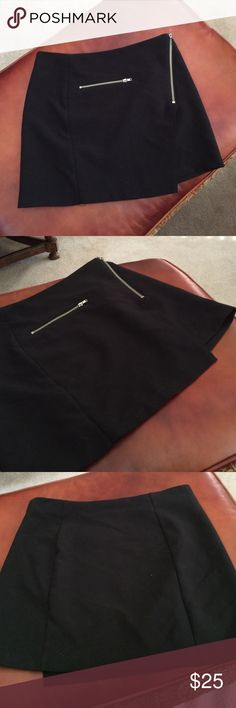 Divided mini skirt Super chic mini skirt by Divided from H&M! Worn a few times - in perfect condition! Features asymmetrical likened and two zippers that add to the piece! Offers are welcome, and feel free to bundle with other items! Divided Skirts Mini