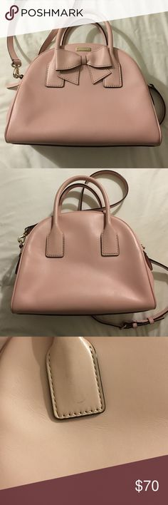 """Kate Spade blush pink bow handbag Incredibly cute blush pink Kate Spade bag. The bottom measures approximately 10.5"""". Height is approximately 8"""". Worn a few times and in good used condition but has a few marks on the back of the bag (see pictures). Shoulder strap is adjustable and detachable. Bag has two pockets inside, one with a zipper. kate spade Bags Shoulder Bags"""
