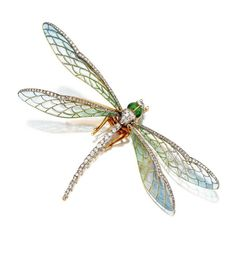 Art Nouveau Plique-à-jour enamel and diamond dragonfly brooch, circa 1900 -  Mounted en tremblant, formed of plique-à-jour enamel in pastel shades of blue and green and edged in rose-cut diamonds, the head and body decorated with old-mine diamonds and translucent apple green enamel, mounted in gold, enamel damaged.  | Sotheby's