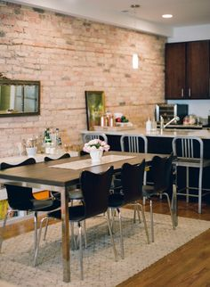 Brick walled dining room