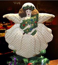 Finished needlepoint angel tree topper