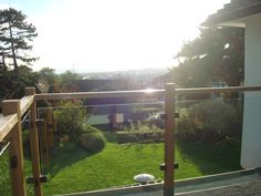 Glass and timber balcony to enjoy some outdoor space. www.shepwayglass.co.uk