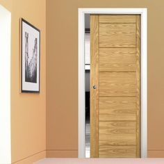 Single Pocket Seville Oak Panel Door, Prefinished. #deantadoor #pocketdoor #moderndlisingdoor