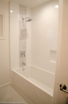 Kohler soaking tub. Hhhhmm, could we install a glass wall at the back shower wall to keep the girls's bathroom light and airy?