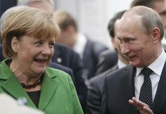 Russian President Vladimir Putin and German Chancellor Angela Merkel chat during the opening of the Hannover Fair in Hannover, Germany, Monday, April 8, 2013.(Photo by Frank Augstein/AP Photo)