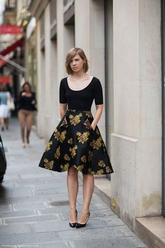 Love this black skirt - right length, right pattern, and it's in proportion to her body.  Great job!