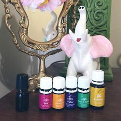 """My personal """"Happy"""" roller: 10 drops of Joy, 8 drops of Citrus Fresh, 4 drops of Peace and Calming, 4 drops of Valor, and 4 drops of Lemon topped off with grapeseed or sunflower oil in a 5 ml bottle. I was using all of these separately every morning and wished I had them all to reapply again through the workday, so I condensed them all into one easy-to-use roller bottle that goes with me everywhere I go! #younglving #essentialoils #yleo #whoilistic #rollerballs"""