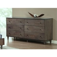 Add a stylish touch to your living space with this light charcoal dresser from Vilas. This six-drawer dresser is finished with a durable, wooden construction.