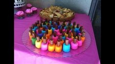 Nail polish bites. Marshmallows dipped in colored frosting, topped with a tootsie roll! Cute little girls party idea.