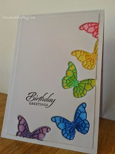 handmade card ... inlaid butterfly dies with negative space behind in coordinating colors ... rainbow order of colors ... crafted by jules ... delightful!