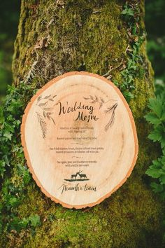 Laser etched wedding reception menus on thin slices of tree trunk are unusual and would fit perfectly with an indoor garden theme.