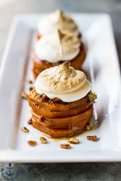 These Sweet Potato Stacks with Toasted Marshmallow Crème are the perfect side for your Thanksgiving table. It's your favorite holiday casserole served up in a delicious little stack!