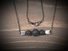 A personal favorite from my Etsy shop https://www.etsy.com/listing/465778005/lava-stones-hematite-plated-arrows-bar