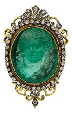 Antique Emerald Cameo, Diamond, Gold Brooch. The brooch features an oval-shaped emerald cameo measuring 23.13 x 19.57 x 10.89 mm, framed by rose-cut diamonds, set in 18k gold. #antique #cameo #brooch