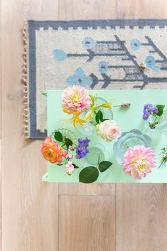 Romantic and colorful flowers in vintage glass vases