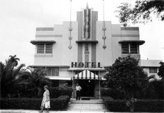 The Neron Hotel was an example of the Art Deco/Streamline Moderne architecture built by architect Henry Hohauser in 1940 at the height of Miami Beach Art Deco period. This image of the Neron Hotel building exhibits many of the trademarks of Art Deco, including basic symmetry from the front elevation view; a ziggurat or stepped roofline; the incorporation of simple, industrially-produced glass bricks as decorative elements; curved edges; eyebrow-like sculpted features; and neon lighting. The…