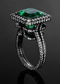 Emerald and diamonds. I love the metal color with the diamonds and the emerald. I do not like this ring though.