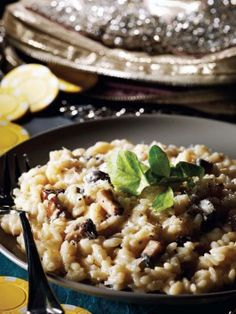 Creamy Gorgonzola and Portobello Mushroom Risotto : Recipes : Cooking Channel.  OMG!  It was soooooooooooooooooooooooooooooo good, but really, where could you go wrong with mushrooms, rice and gorgonzola.  Husband doesn't love gordonzola, but through it was the perfect amount.  Subtle, but present.