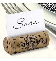 Amazing dinner party idea: Slit the top of a wine cork and insert a name tag for a cute and unique place holder by David Tutera