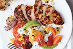 This 450-calorie dinner is full of flavor (and 39g of protein!).Cooking Light'sGrilled Chicken with Tomato Avocado Salad uses homemade buttermilk dressing to balance the heat of the chicken. Chic...