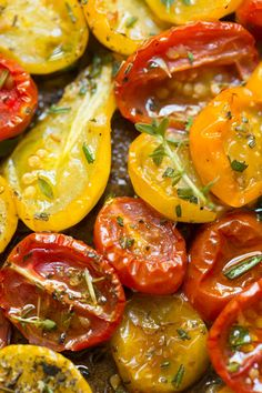 Garlic and Herb Roasted Tomatoes - these incredibly flavorful roasted tomatoes are wonderful in salads, pasta dishes, on pizzas,…
