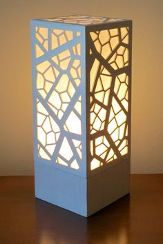 """Cellular Lasercut Lamp by Foxworth Architecture PLLC Lamp Design, Lighting Design, Modern Window Design, Laser Cut Lamps, Jaali Design, Leaf Stencil, Wooden Lampshade, Home Decor Shelves, Lantern Designs"
