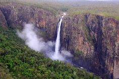 Wallaman Falls is the largest single drop waterfall in Australia, tumbling 305 metres through a rainbow-fringed cloud of mist to a large pool. Photo taken from a helicopter.  Far North Queensland, #Australia. #nature #landscapephotography