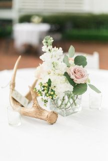 Rustic-elegant antler and floral centerpiece:  http://www.stylemepretty.com/mississippi-weddings/natchez-mississippi/2015/08/21/classic-southern-wedding-2/ | Photography: Luke & Cat - http://lukeandcat.com/