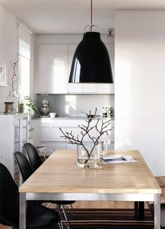 kitchen + dining. branch in a glass vase. styling Pella Hedeby