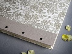 "IONA BINDING - Handmade photo album measures 14,37"" x 13,54"". Covered with gold floral print paper."