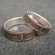 This is a reversal of an earlier style with the sterling silver on the inside for the lining and the tab, and the inlay and side rails cast in 14k rose gold.  The larger band measures 6mm wide, the smaller about 4mm.