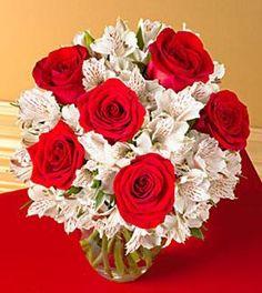 Red roses with atroemerias