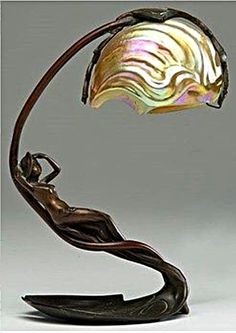 Art Nouveau Nautilus table lamp by C. Bonnefond, French, late or early century. An art nouveau lamp with a bronze base of a reclining nymph on a lily pad and an iridescent shade in the shape of a nautilus shell, base signed C. Motifs Art Nouveau, Design Art Nouveau, Bijoux Art Nouveau, Bronze, Muebles Estilo Art Nouveau, Chandelier Design, Restaurant Design, Lampe Art Deco, Art Deco Table Lamps