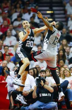 San Antonio Spurs guard Manu Ginobili (20) and Houston Rockets guard James Harden (13) battle for a rebound during the first half of Game 3 of the second round of the Western Conference NBA playoffs at the Toyota Center, Sunday, May 7, 2017, in Houston. ( Karen Warren / Houston Chronicle ) Photo: Karen Warren/Houston Chronicle