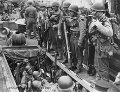 June the 1st 1944. 6.45 pm. Everyone is embarking with a box of pills for seasickness, two paper bags in case the pills don't work, a small paperback book to pass the time, three K-rations for D-Day,  plus three D-rations of chocolate with extra vitamins. 800 guys are transported by LCAs on the Empire Javelin, a freight ship turned into a troop transporter, anchored in Portland Harbour.