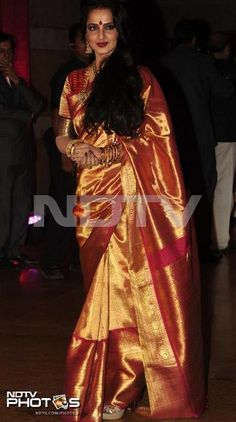 Rekha in golden saree - in the new breed of Kanchi sprees. More and more gold weave