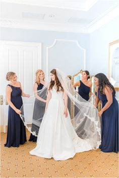 bridesmaids in navy gowns help bride prepare for Farmingdale NJ wedding | Eagle Oaks Golf and Country Club in Farmingdale, NJ photographed by New Jersey wedding photographer Idalia Photography. Planning a classic wedding? Find inspiration here! #IdaliaPhotography #EagleOaksGolfClub #NJWeddingPhotographer