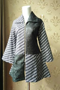 .bahan batik cap primisima mix katun  warna hitam dengan motif timbul yang cantik dan adem. .resleting depan bisa juga digunakan untuk blazer/outer .mode...