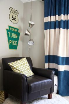 Boy room - road signs and a curtain made out of a painter's dropcloth!