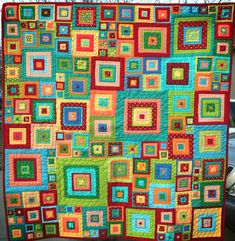 Jewel Squares by Shea, the empty bobbin from Glorious Patchwork by Kaffe Fasset