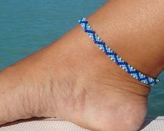 Zig Zag Daisy ankle bracelet is beaded with Turquoise, Cobalt Blue and White Ceylon beads. It is finished off a Silve. - -This Zig Zag Daisy ankle bracelet is beaded with Turquoise, Cobalt Blue and White Ceylon beads. It is finished off a Silve. Silver Ankle Bracelet, Ankle Bracelets, Beaded Bracelets, Bleu Cobalt, Beach Anklets, Lace Necklace, Handmade Beaded Jewelry, Jewellery Uk, Fashion Jewelry